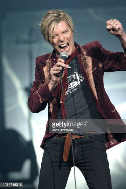 Singer, songwriter and actor David Bowie is shown performing on stage during a live concert appearance on December 16, 2003.