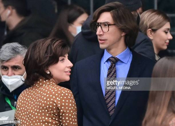 Singer, songwriter and actress Lady Gaga and US actor Adam Driver are pictured on March 11, 2021 on Piazza Duomo in central Milan on the set of the...