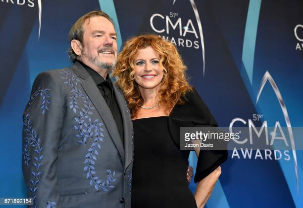 Singer Songwriter and Composer Jimmy Webb and Laura Savini pose in the press room at the 51st annual CMA Awards at the Bridgestone Arena on November...