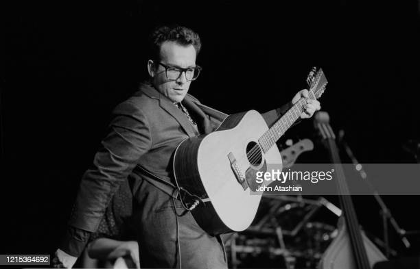 Singer, songwriter and guitarist Elvis Costello is shown performing on stage during a live concert appearance on August 15, 1999.