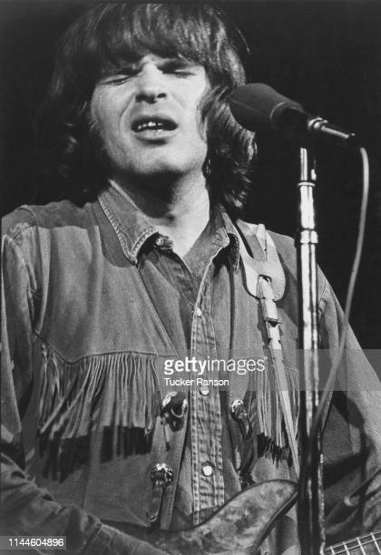 Singer songwriter and guitarist John Fogerty performing with American rock group Creedence Clearwater Revival at the Woodstock Music Festival Bethel...