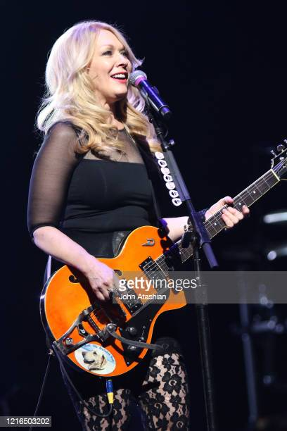 """Singer, songwriter and guitarist Nancy Wilson is shown performing on stage during a """"live"""" concert appearance with Heart on July 25, 2016. """"n"""