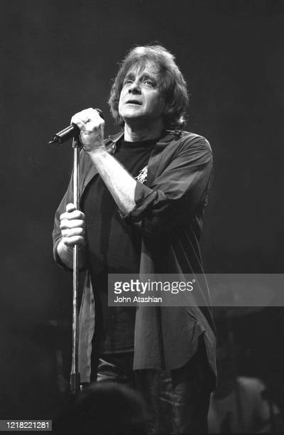 """Singer, songwriter and musician Eddie Money is shown performing on stage during a """"live"""" concert appearance on February 14, 2001."""