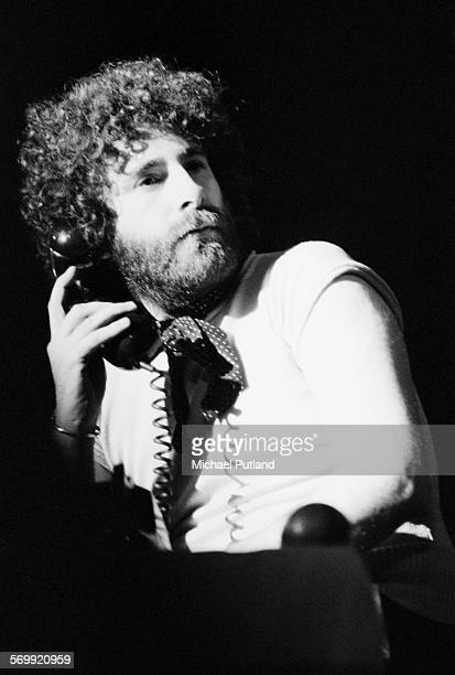 Singer songwriter and musician Kevin Godley on stage with English rock band 10cc February 1976