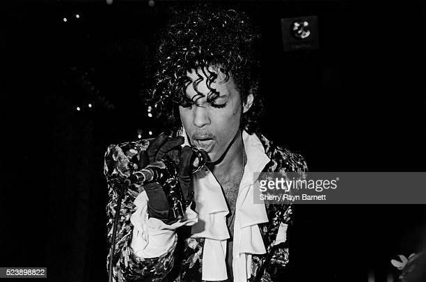 Singer songwriter and musician Prince performs at the Hollywood Palace to promote the opening of his film 'Purple Rain' on July 26 1985 in Los...