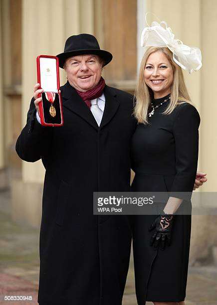 Singer songwriter and musician Sir Van Morrison at Buckingham Palace London with daughter Shana Morrison after he was knighted by the Prince of Wales...
