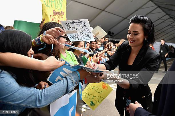 Singer songwriter and philanthropist Demi Lovato signs autographs for fans on the WE Carpet at WE Day California 2016 at The Forum on April 7 2016 in...