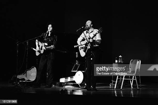 Singer songwriter Arlo Guthrie and folk singer and activist Pete Seeger share a stage together performing at Carnegie Hall on March 8, 1974 in New...