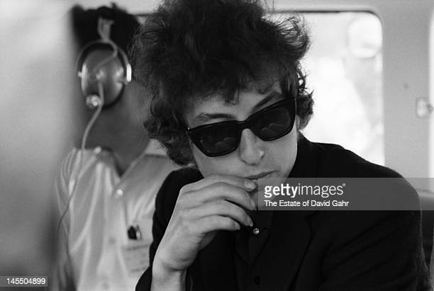 Singer songwriter Bob Dylan backstage before a performance at the Newport Folk Festival on July 25 1965 in Newport Rhode Island