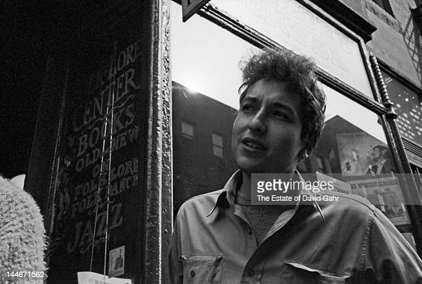 Singer songwriter Bob Dylan poses for a portrait in May 1962 in front of the Folklore Center the legendary folk music store on MacDougal Street in...
