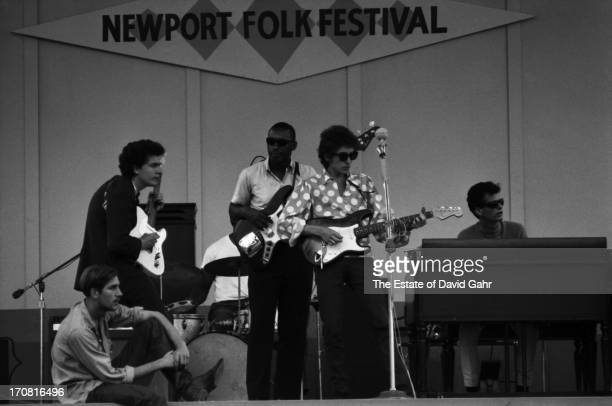 Singer songwriter Bob Dylan rehearses with Mike Bloomfield Sam Lay Jerome Arnold and Al Kooper before his renowned electric debut at the Newport Folk...