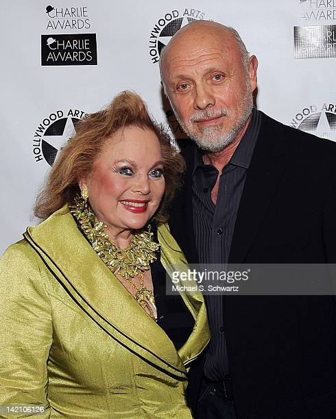 Singer / songwriter Carol Connors and Actor Hector Elizando pose during the 26th Annual Charlie Awards Luncheon at Hollywood Roosevelt Hotel on March...