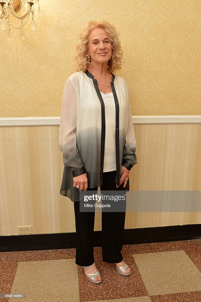 Singer, songwriter Carole King poses in a press room at the 68th Annual Tony Awards on June 8, 2014 in New York City.