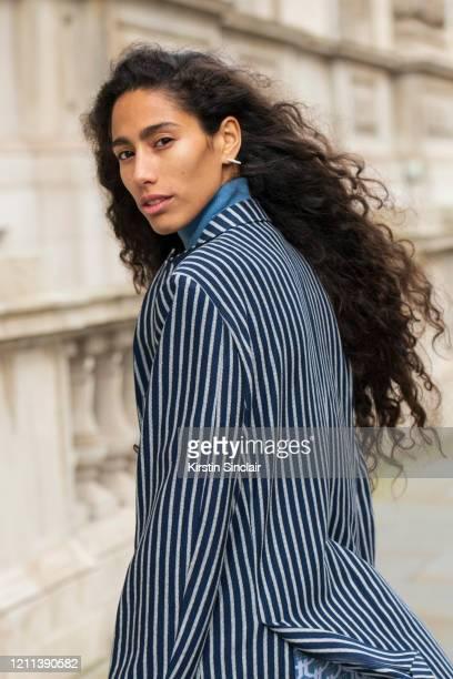 Singer Songwriter Ciinderella Balthazar wears a Dak's blazer during London Fashion Week February 2020 on February 18 2020 in London England