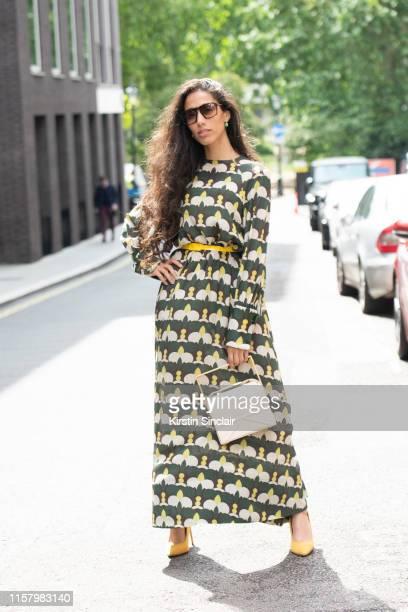 Singer songwriter Ciinderella Balthazar wears a Daks dress, Clémence Flane bag, Gianvito Rossi shoes during London Fashion Week Men's June 2019 on...