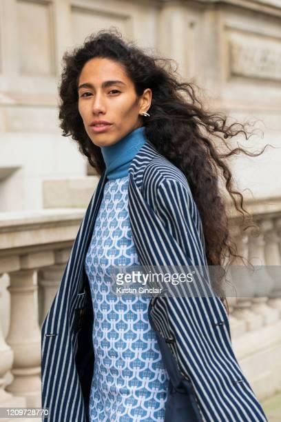 Singer Songwriter Ciinderella Balthazar wears a Dak's dress polo neck jumper and blazer during London Fashion Week February 2020 on February 18 2020...