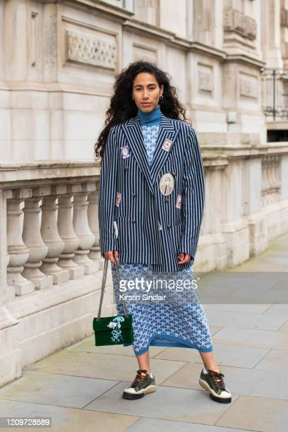 Singer Songwriter Ciinderella Balthazar wears Chloé trainers Kurt Geiger bag Dak's dress polo neck jumper and blazer during London Fashion Week...
