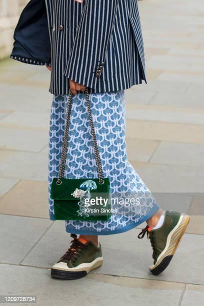 Singer Songwriter Ciinderella Balthazar wears Chloé trainers Kurt Geiger bag Dak's dress and blazer during London Fashion Week February 2020 on...