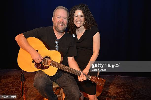 Singer Songwriter Don Schlitz poses with The Country Music Hall of Fame Public Programs Coordinator Abi Tapia at Country Music Hall of Fame and...