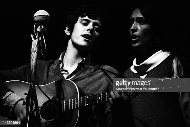 Singer songwriter Donovan and folk singer Joan Baez perform together at the Newport Folk Festival in July 1965 in Newport Rhode Island