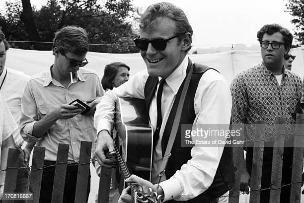 Singer songwriter Gordon Lightfoot rehearses backstage before his debut performance at the Newport Folk Festival in July 1965 in Newport Rhode Island