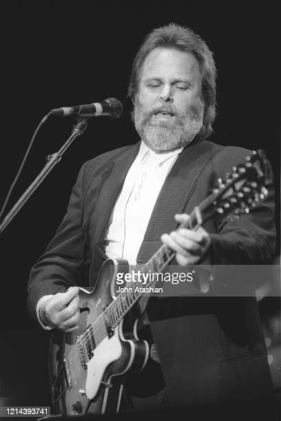 Singer, songwriter & guitarist Carl Wilson is shown performing on stage during a live concert appearance with The Beach Boys on June 1, 1991.