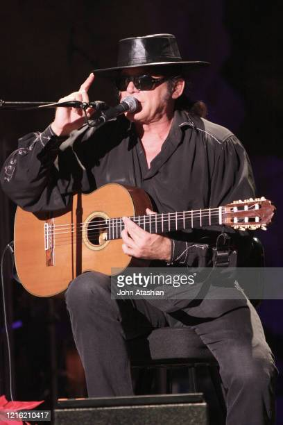 """Singer, songwriter & guitarist Esteban is shown performing on stage during a """"live"""" concert appearance on December 26, 2009."""