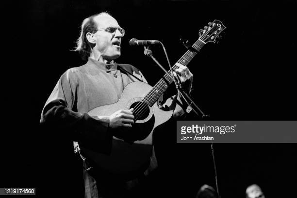 Singer songwriter guitarist James Taylor is shown performing on stage during live concert appearance on July 15 1995