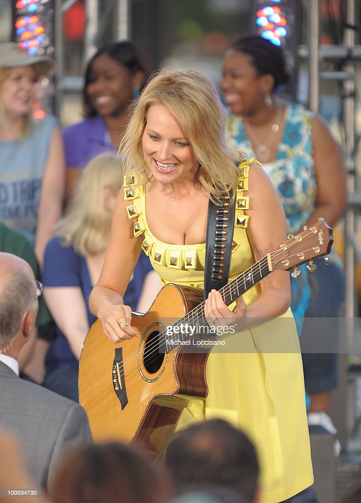 Singer songwriter Jewel (R) talks with CBS co-anchor Harry Smith during her performance on CBS' The Early Show Summer Concert Series at the CBS Early Show Studio Plaza on May 25, 2010 in New York City.
