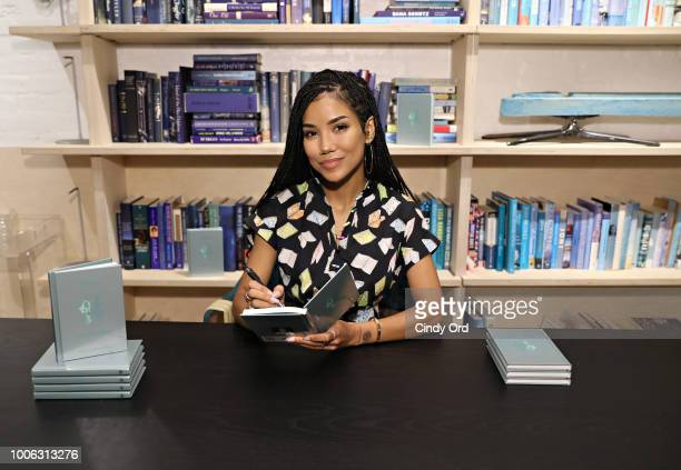 Singer/ songwriter Jhene Aiko signs books for attendees during the Jhene Aiko Trip Film 2Fish book signing on July 26 2018 in New York City