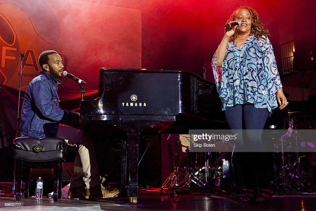 Singer songwriter John Legend and jazz singer Cassandra Wilson perform at the GULF AID benefit concert at Mardi Gras World River City on May 16, 2010 in New Orleans, Louisiana.
