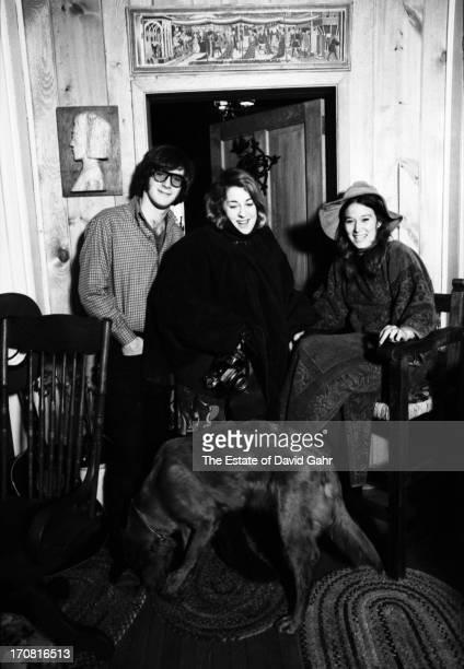 Singer songwriter John Sebastian singer Cass Elliot and Mr Sebastian's wife Lori pose for a portrait at the Sebatian's home on December 22 1966 in...