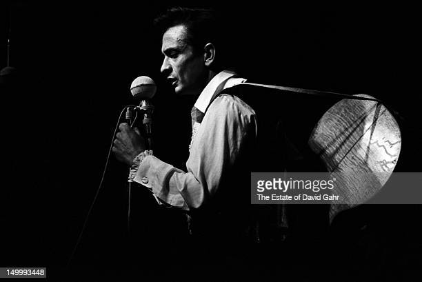 Singer songwriter Johnny Cash performs at the Newport Folk Festival in July 1964 in Newport Rhode Island