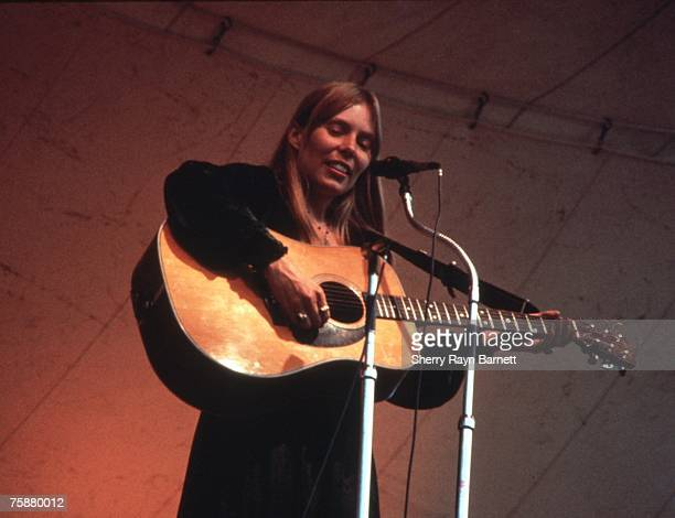 Singer songwriter Joni Mitchell performs at the Central Park Music Festival in New York, New York in 1969.
