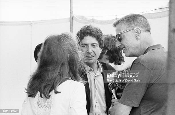 Singer songwriter Leonard Cohen and legendary record producer music critic and social activist John Hammond II backstage at the Newport Folk Festival...