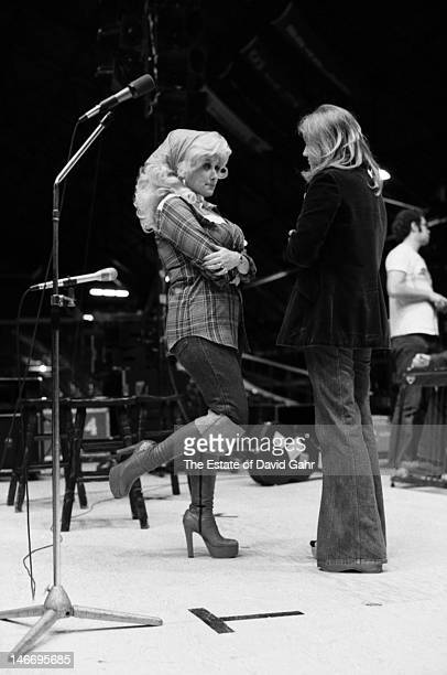 Singer songwriter musician and actress Dolly Parton chsts with a reporter before her concert on March 12 1977 at Bradley University in Peoria Illinois