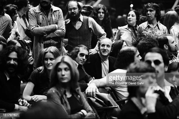 Singer songwriter Paul Simon and record producer and music industry executive Clive Davis attend a performance by Bob Dylan and The Band at Madison...