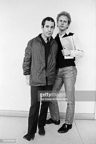 Singer songwriter Paul Simon and singer Art Garfunkel of the musical duo Simon and Garfunkel pose for a portrait in April 1968 in New York City New...