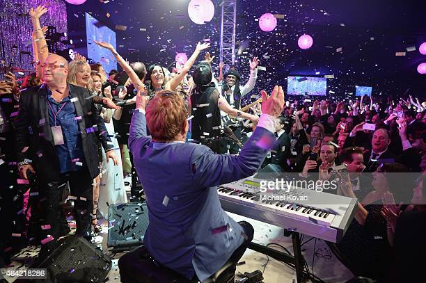 Singer songwriter Sir Elton John performs on stage with Nile Rodgers during the 23rd Annual Elton John AIDS Foundation Academy Awards Viewing Party...