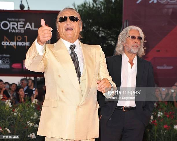 Singer songwriter Tony Renis and music producer Michele Torpedine attend the Il Villaggio Di Cartone premiere during 68th Venice Film Festival at...