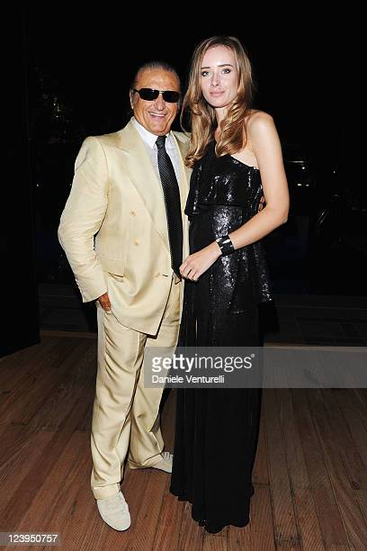 Singer songwriter Tony Renis and Olga Sorokina attend the Charity Gala 2011 for UNICEF at the Lancia Cafe on September 6 2011 in Venice Italy