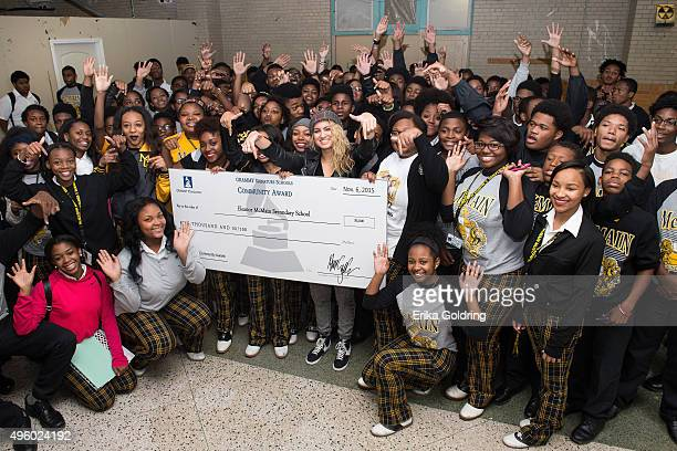 Singer songwriter Tori Kelly gathers with McMain students during the GRAMMY Foundation Signature Schools grant presentation at McMain Secondary...