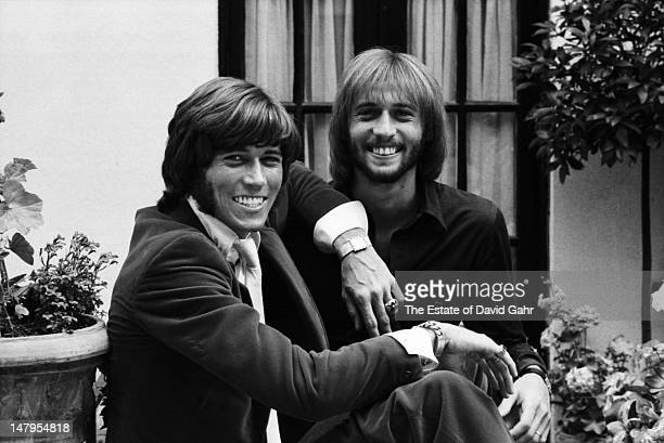 Singer songwriters and members of the musical trio the Bee Gees Barry Gibb and Maurice Gibb pose for a portrait in London England in July 1969