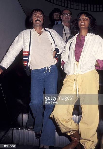 Singer Sonny Bono and girlfriend Susie Coelho on March 19 1977 arrive at the Los Angeles International Airport in Los Angeles California