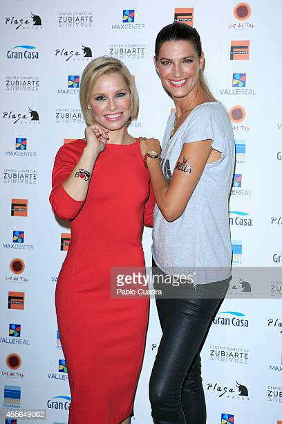 Singer Soraya Arnelas and model Laura Sanchez pose during a photocall to present 'Me Pongo En Tu Piel' on September 18 2014 in Madrid Spain