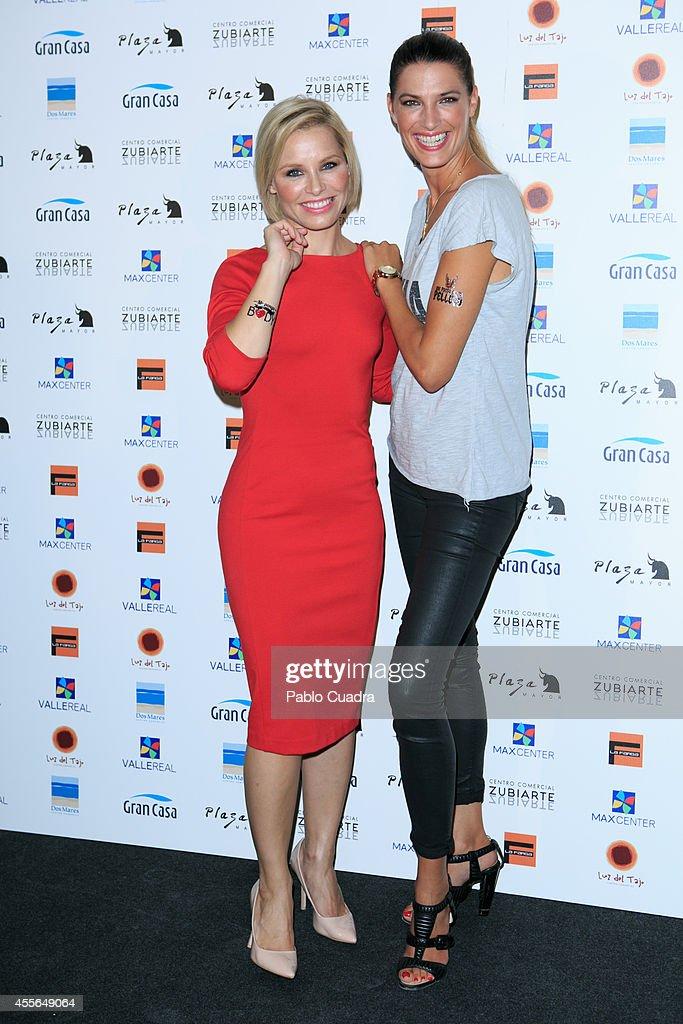 Singer Soraya Arnelas (L) and model Laura Sanchez (R) pose during a photocall to present 'Me Pongo En Tu Piel' on September 18, 2014 in Madrid, Spain.
