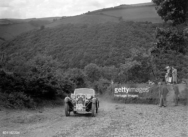 Singer sports competing in the Mid Surrey AC Barnstaple Trial Beggars Roost Devon 1934 Artist Bill BrunellSinger Sports 1934 972 cc Vehicle Reg No...