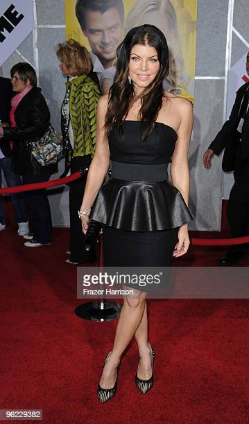 Singer Stacy Ferguson Fergie from Black Eyed Peas arrives at the premiere Of Touchstone Pictures' When in Rome at the El Capitan Theatre on January...