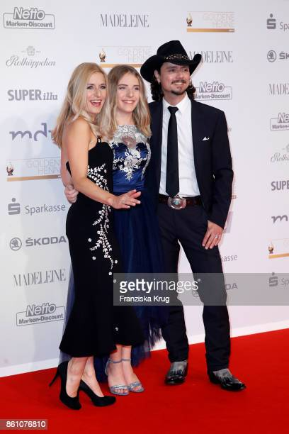Singer Stefanie Hertel her daughter Johanna and her husband singer Lanny Lanner attend the Goldene Henne on October 13 2017 in Leipzig Germany