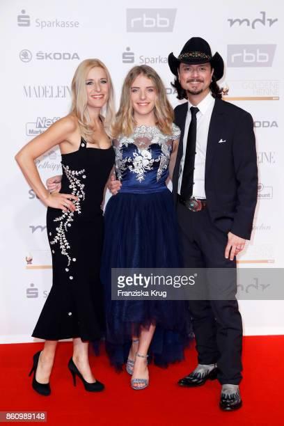 Singer Stefanie Hertel her daughter Johanna Dorst and her husband singer Lanny Lanner attend the Goldene Henne on October 13 2017 in Leipzig Germany